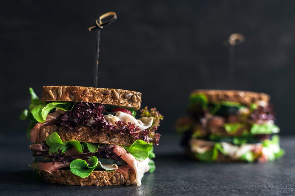two deli sandwiches