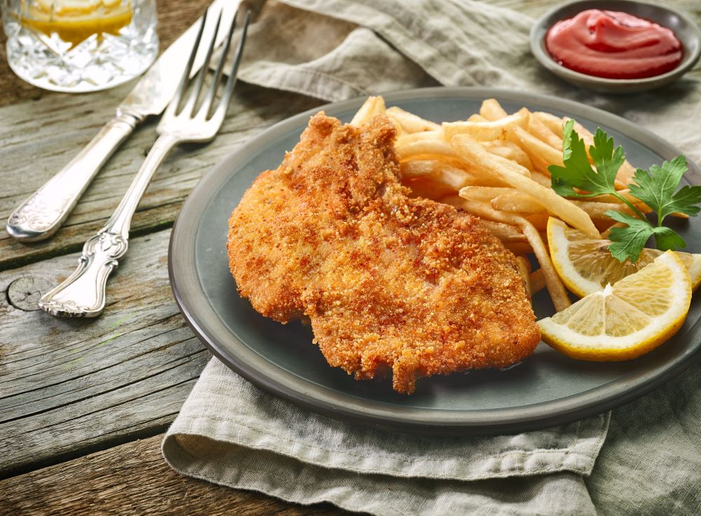 plated schnitzel with french fries