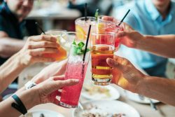people clinking drinks