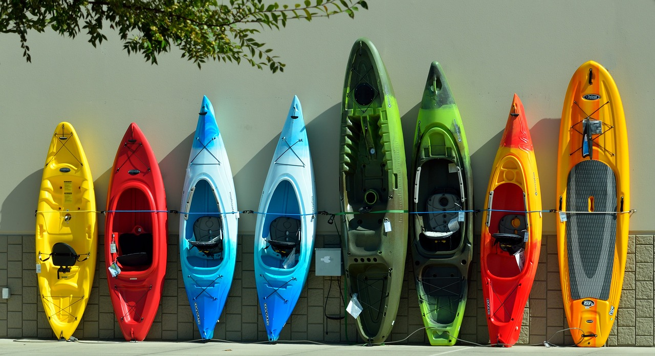 kayaks lined up against a wall