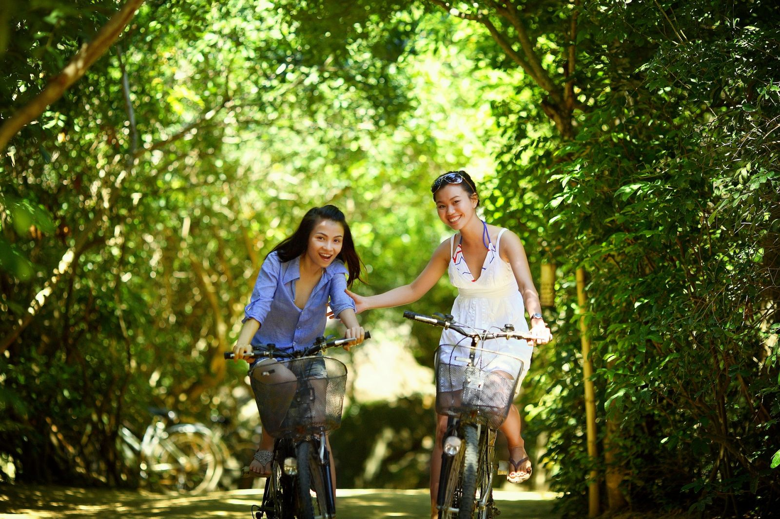 two women riding bikes