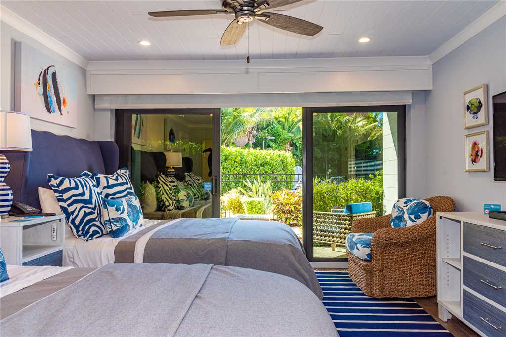 Interior of two queen beds leading to patio in Anna Maria Island
