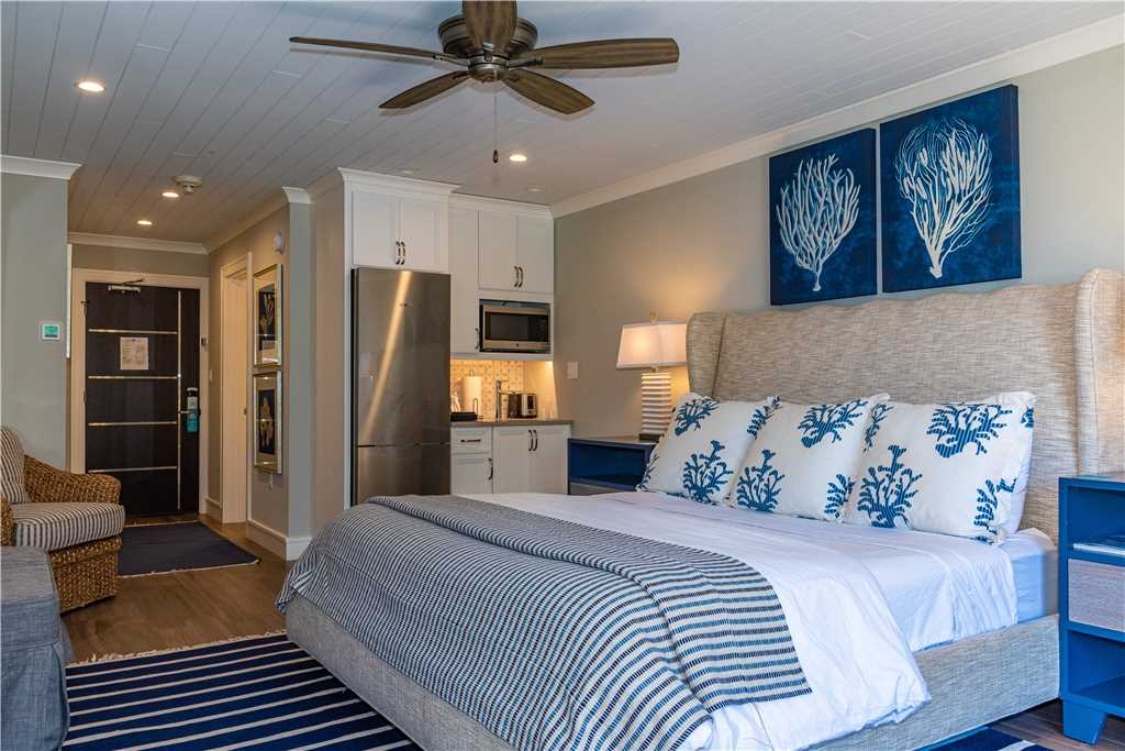 Interior king bed and kitchen in Anna Maria Island