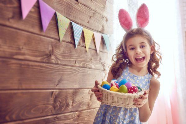 little girl holding easter eggs