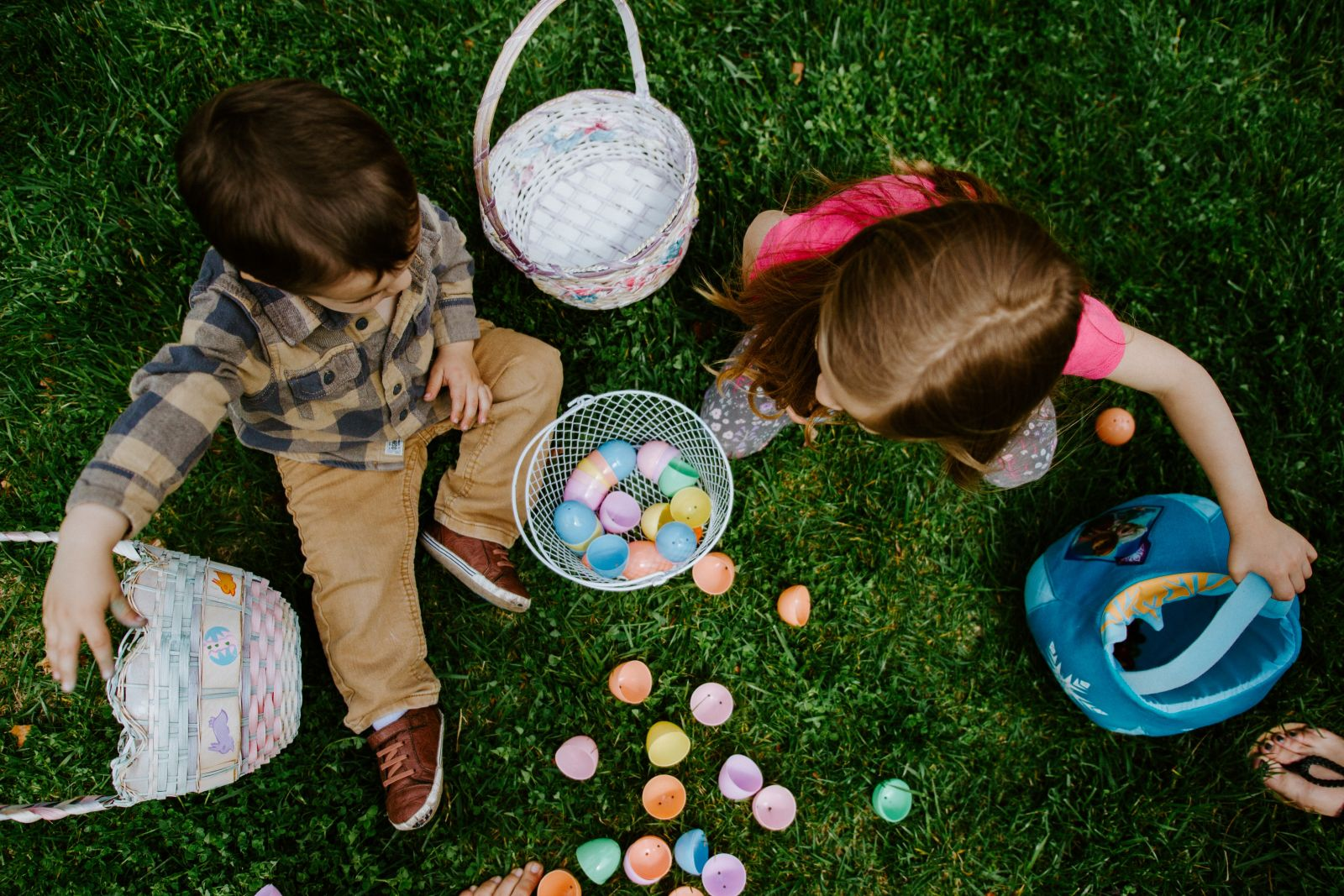 Kids looking at all their Easter eggs that they collected on Anna Maria Island