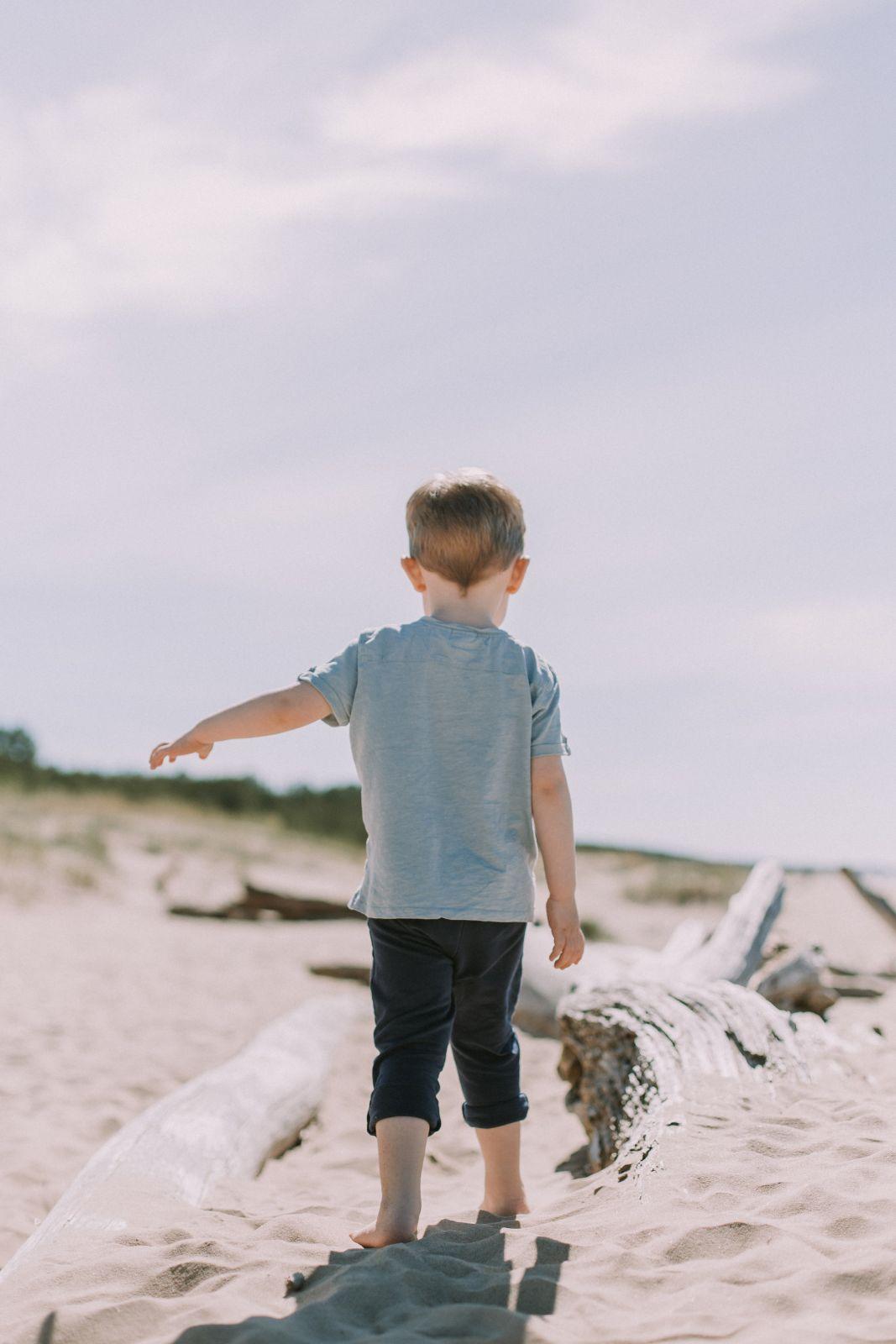 Toddler walking on Anna Maria Island beach