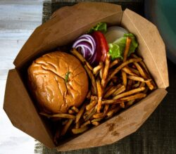 Burger and fries to go in the box