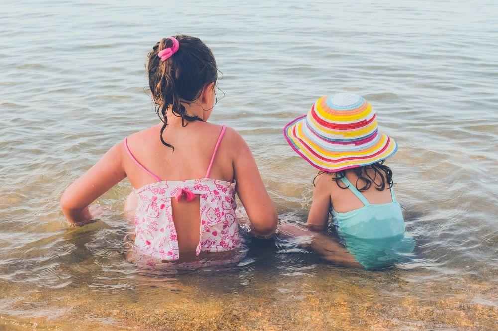 little kids in ocean