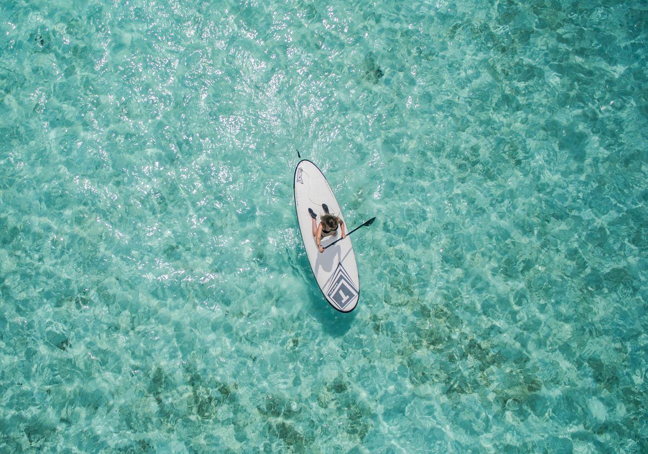 woman paddleboarding on anna maria island ocean